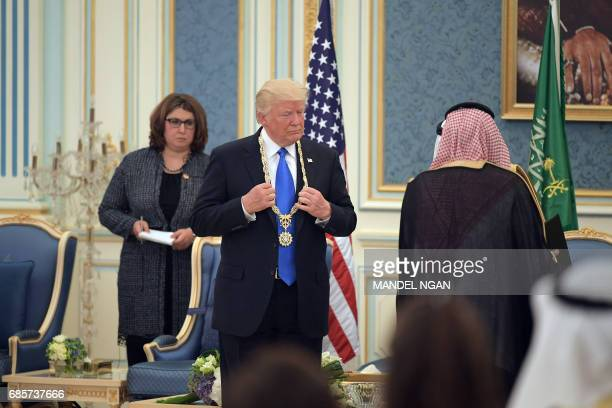 US President Donald Trump receives the Order of Abdulaziz alSaud medal from Saudi Arabia's King Salman bin Abdulaziz alSaud at the Saudi Royal Court...