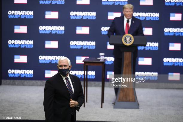 President Donald Trump recognizes U.S. Vice President Mike Pence during an Operation Warp Speed vaccine summit at the White House in Washington,...