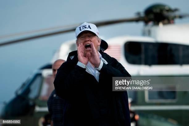 US President Donald Trump replies to a question from the press while boarding Air Force One at Andrews Air Force Base in Maryland on September 14 as...