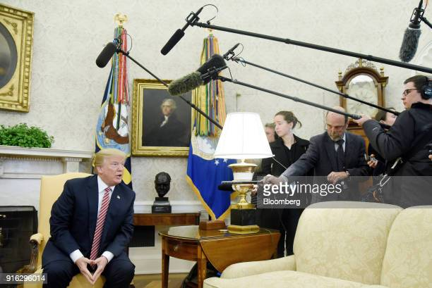 US President Donald Trump responds to a question from members of the media during a meeting in the Oval Office of the White House in Washington DC US...