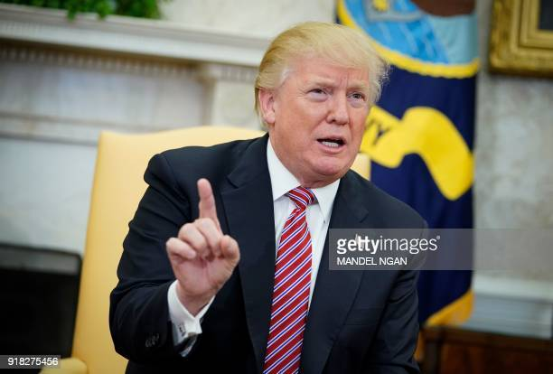 US President Donald Trump responds to a reporter's question on domestic violence following a working session regarding opportunity zones following...