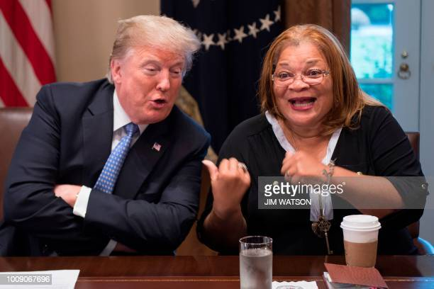 President Donald Trump responds to Dr. Alveda King, niece of Dr. Martin Luther King Jr., during a meeting with inner city pastors at the White House...