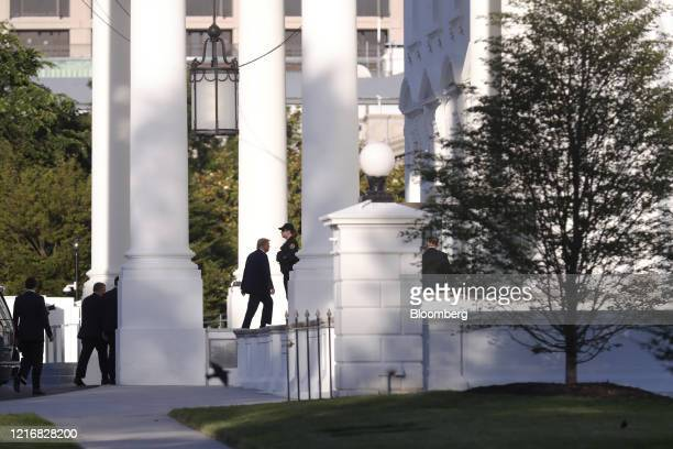 US President Donald Trump returns to the White House after posing with a bible outside St John's Episcopal Church in Washington DC US on Monday June...