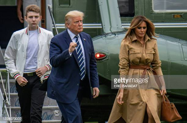 President Donald Trump returns to the White House with First Lady Melania Trump and their son Baron after a weekend in Bedminster on August 16, 2020...