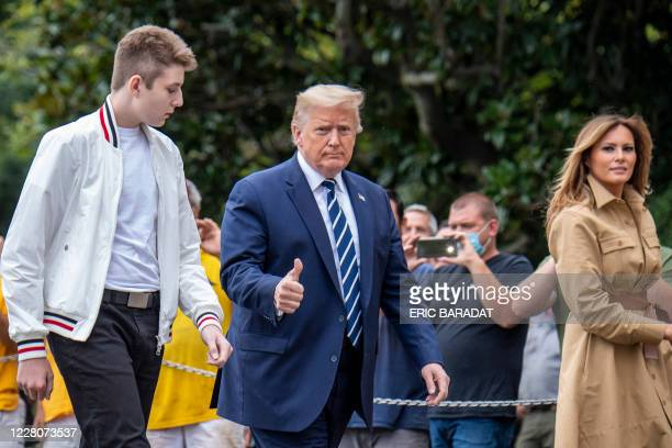 US President Donald Trump returns to the White House with First Lady Melania Trump and their son Baron after a weekend in Bedminster on August 16...