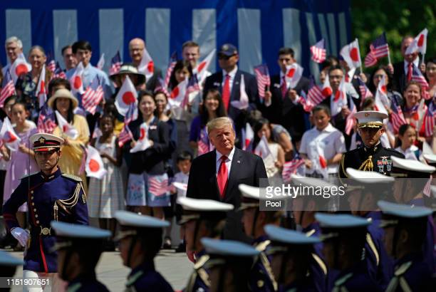 President Donald Trump reviews the guard of honor during a welcoming ceremony at the Imperial Palace on May 27 2019 in Tokyo Japan President Trump is...