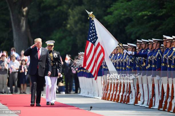 S President Donald Trump reviews the honour guard during the welcome ceremony at the Imperial Palace on May 27 2019 in Tokyo Japan President Trump is...