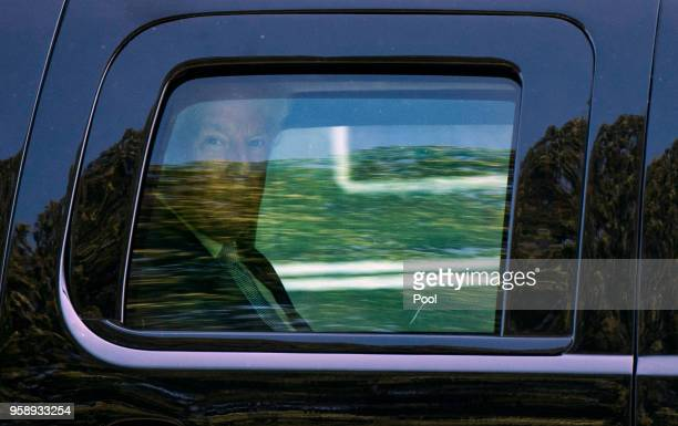 President Donald Trump rides in a SUV after arriving at Walter Reed Medical Center to visit First Lady Melania Trump who is undergoing treatment for...