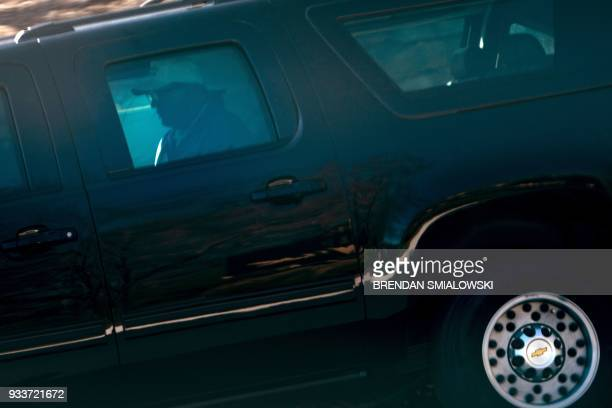 US President Donald Trump rides in an armored vehicle while leaving the Trump National Golf Club March 18 in Sterling Virginia / AFP PHOTO / Brendan...