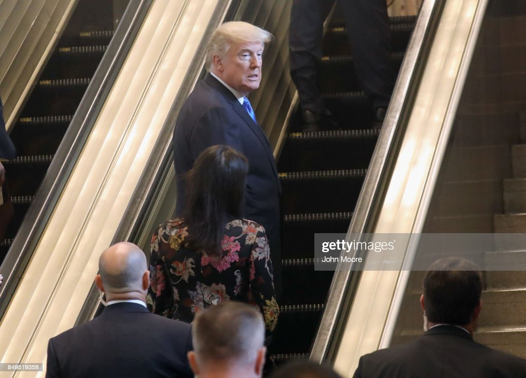 U.S. President Donald Trump rides up an escalator at the United Nations headquarters on September 19, 2017 in New York City. He addressed world leaders at his first UN General Assembly meeting.