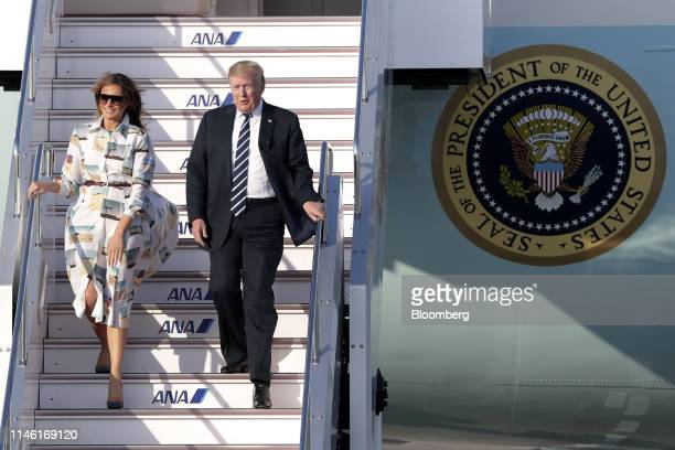 US President Donald Trump right and First Lady Melania Trump disembark from Air Force One after arriving at Haneda Airport in Tokyo Japan on Saturday...