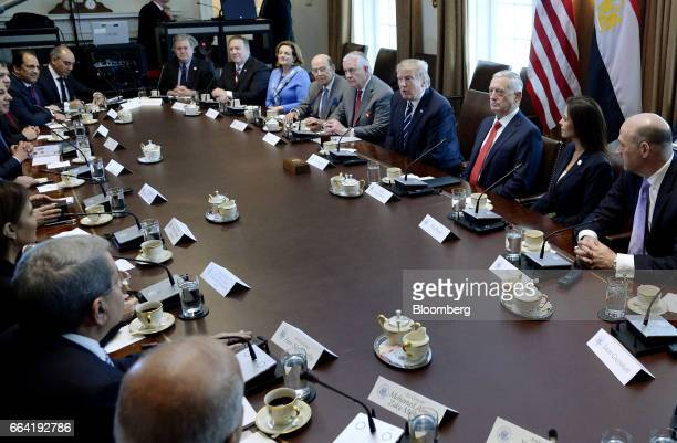 US President Donald Trump right and his cabinet attend a meeting with AbdelFattah ElSisi Egypt's president not pictured and his delegation in the...