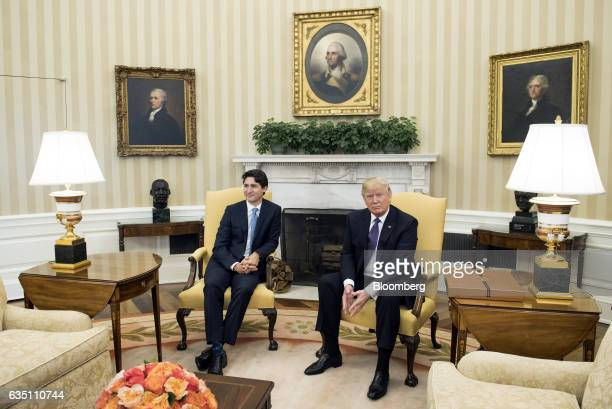 US President Donald Trump right and Justin Trudeau Canada's prime minister sit for photographs during a meeting in the Oval Office of the White House...