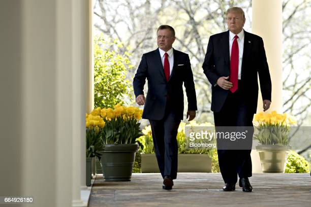 US President Donald Trump right and King Abdullah II of Jordan arrive to a news conference in the Rose Garden of the White House in Washington DC US...