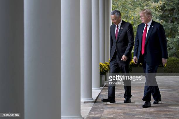 US President Donald Trump right and Lee Hsien Loong Singapore's prime minister walk towards the Rose Garden to make a joint statement at the White...