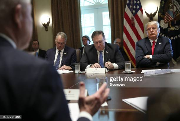 US President Donald Trump right and Mike Pompeo US secretary of state center listen during a meeting in the Cabinet Room of the White House in...