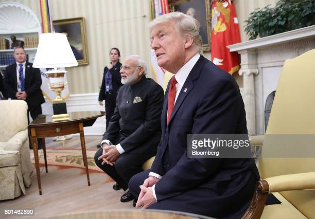 US President Donald Trump right and Narendra Modi India's prime minister sit during a meeting at the Oval Office of the White House in Washington DC...