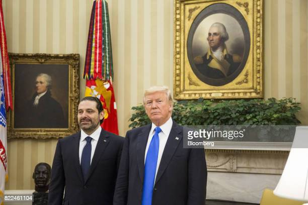 US President Donald Trump right and Saad Hariri Lebanon's prime minister stand for photographs during a meeting in the Oval Office of the White House...