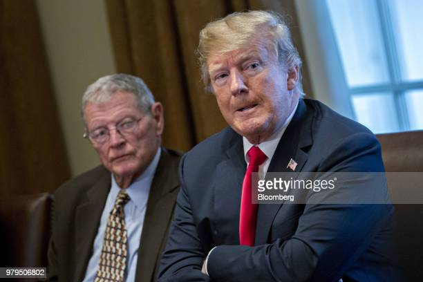 US President Donald Trump right and Senator James Inhofe a Republican from Oklahoma wait while members of the press are escorted out of the room...