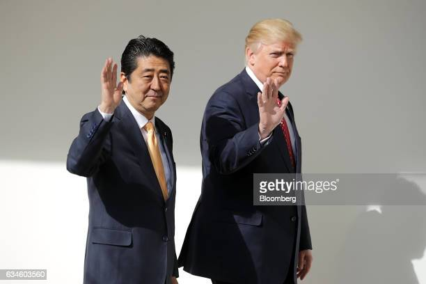 US President Donald Trump right and Shinzo Abe Japan's prime minister wave while walking to a joint news conference in the East Room of the White...