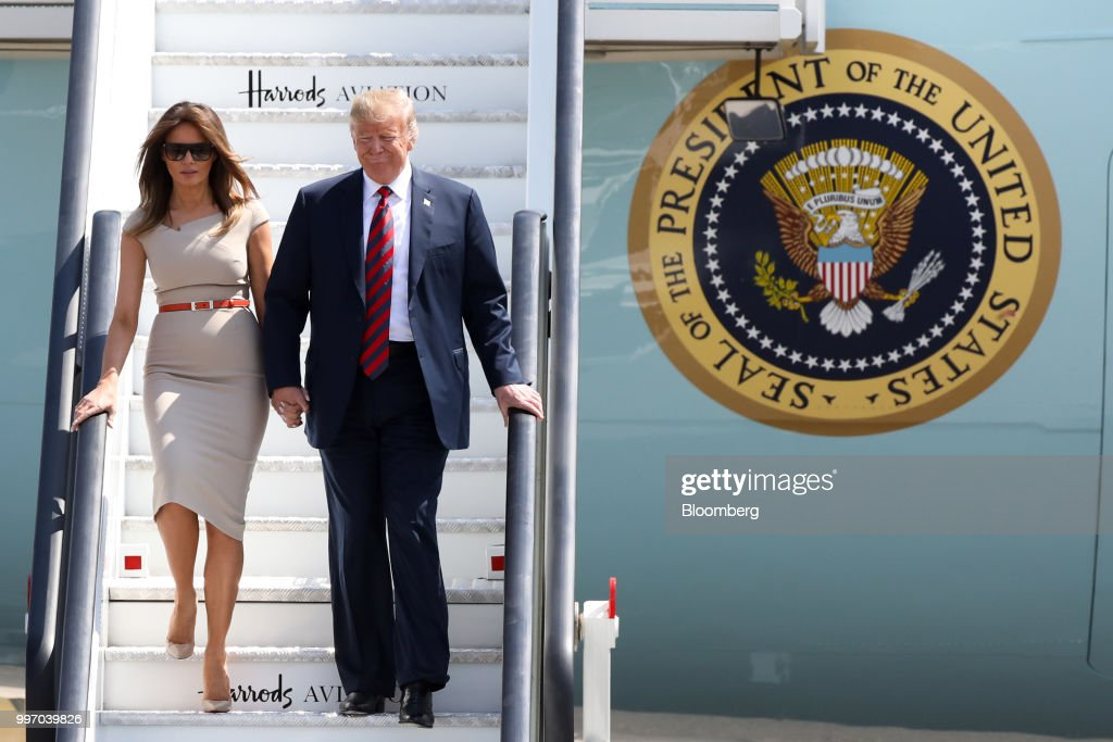 U.S. President Donald Trump, right, and U.S. First Lady Melania Trump disembark from Air Force One after arriving at London Stansted Airport in Stansted, U.K., on Thursday, July 12, 2018. Trump will avoid London as much as possible as he's whisked off on a tour of prime British real estate to keep him away from protesters during his U.K. visit. Photographer: Chris Ratcliffe/Bloomberg via Getty Images