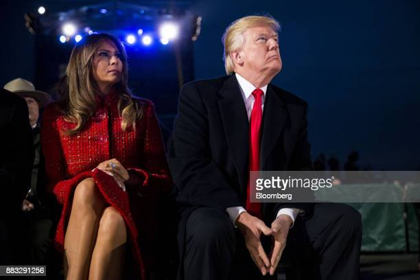 US President Donald Trump right and US First Lady Melania Trump sit during the 95th Annual National Christmas Tree Lighting in Washington DC US on...