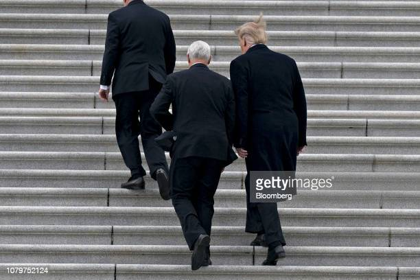 US President Donald Trump right and US Vice President Mike Pence left arrive to the US Capitol for a meeting with Senate Republicans in Washington DC...