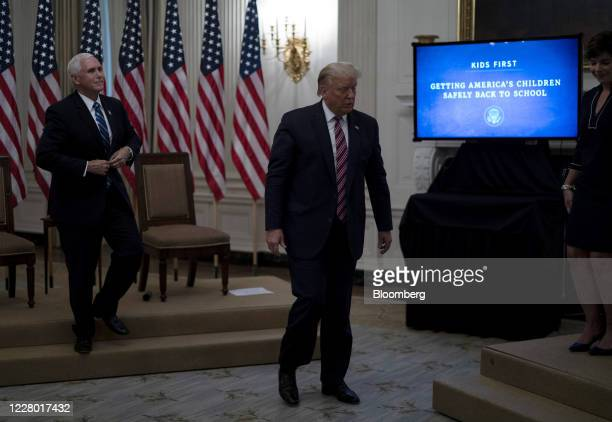 US President Donald Trump right and Vice President Mike Pence attend an event on opening schools in the State Dining Room of the White House in...