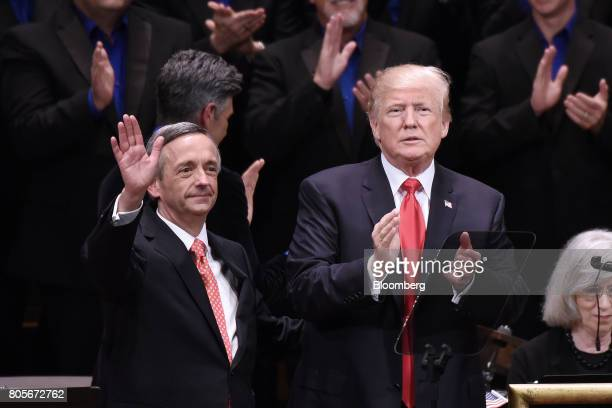 US President Donald Trump right applauds as pastor Robert Jeffress waves during the Celebrate Freedom event at the John F Kennedy Center for the...