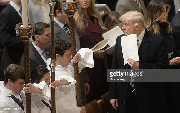 US President Donald Trump right attends the National Prayer Service at the National Cathedral in Washington DC on Saturday Jan 21 2017 Trump began...