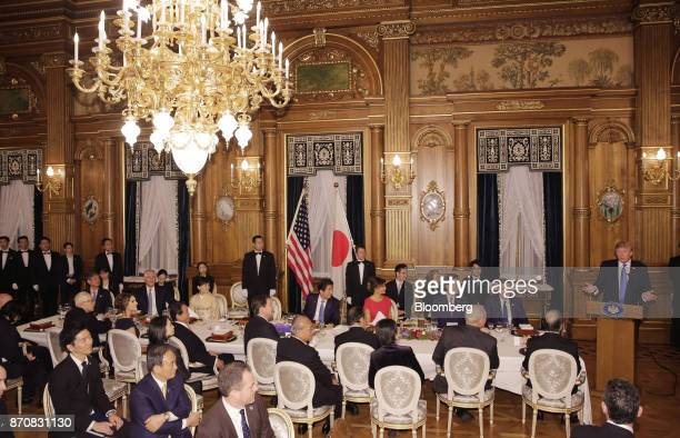 US President Donald Trump right delivers a speech during a state banquet at Akasaka Palace in Tokyo Japan on Monday Nov 6 2017 Trump urged Japan's...