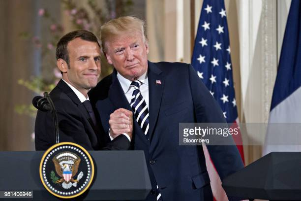 S President Donald Trump right embraces Emmanuel Macron France's president at a news conference in the East Room of the White House during a state...