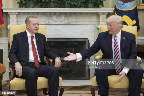 US President Donald Trump right extends a hand to Recep Tayyip Erdogan Turkey's president during a meeting at the Oval Office of the White House in...