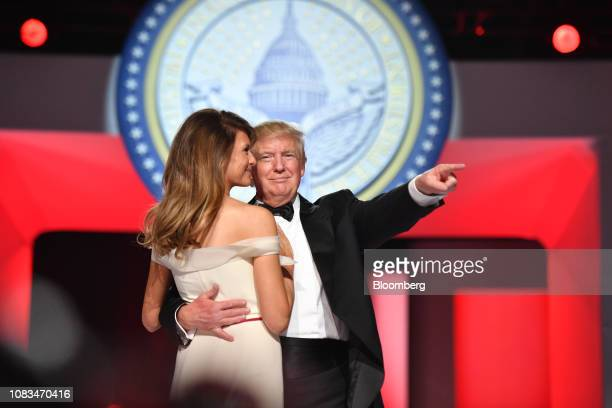 President Donald Trump, right, gestures as he dances with First Lady Melania Trump during the Freedom Ball in Washington, D.C., on Friday, Jan. 20,...