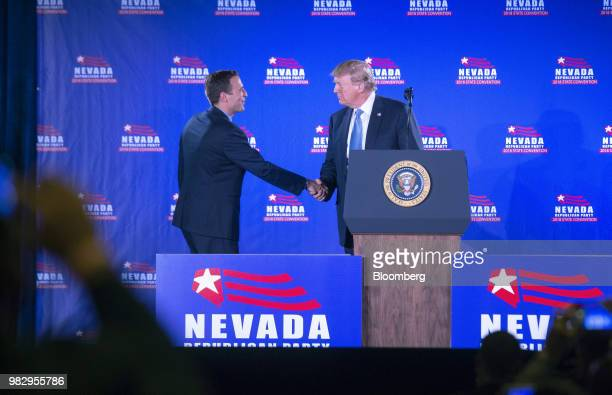 US President Donald Trump right greets Adam Laxalt Nevada's attorney general on stage during the Nevada Republican Party Convention at the Suncoast...