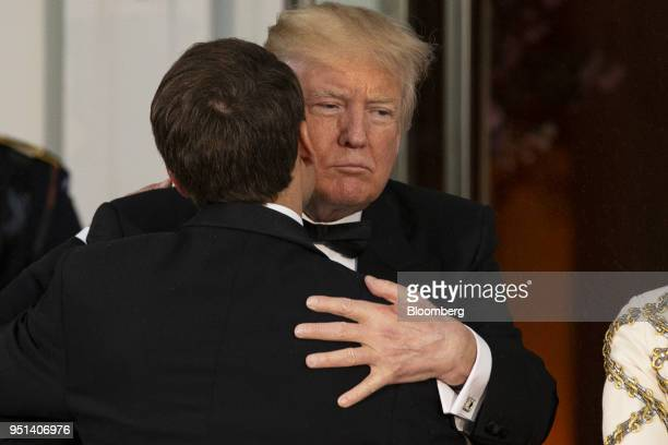 S President Donald Trump right greets Emmanuel Macron France's president on the North Portico ahead of a State Dinner at the White House in...