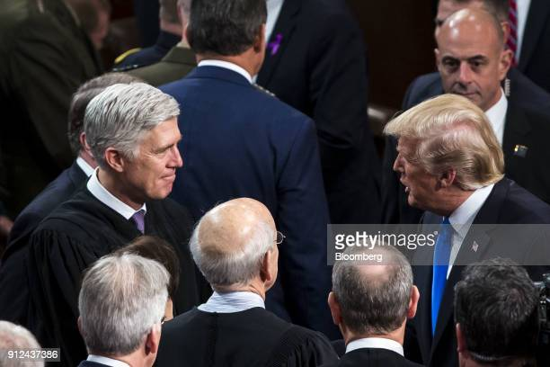 US President Donald Trump right greets Neil Gorsuch associate justice of the Supreme Court left after delivering a State of the Union address to a...