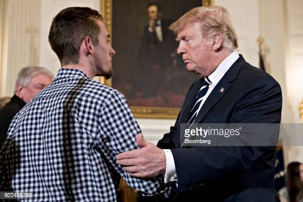 US President Donald Trump right greets Samuel Zeif Marjory Stoneman Douglas High School student at a listening session on gun violence with high...