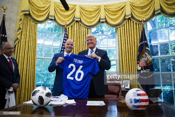US President Donald Trump right is presented a game jersey by Gianni Infantino president of FIFA center as Carlos Cordeiro president of the United...