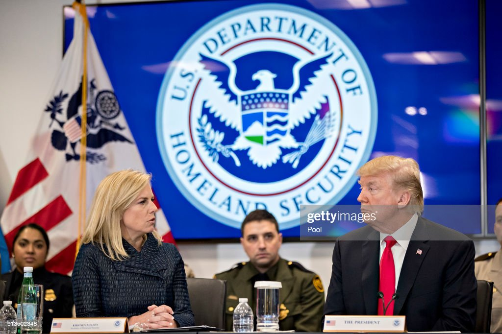 U.S. President Donald Trump, right, listens as Kirstjen Nielsen, secretary of Homeland Security, speaks during a Customs and Border Protection (CBP) roundtable discussion at the CBP National Targeting Center February 2, 2018 in Sterling, Virginia. Trump is looking to ratchet up pressure on lawmakers to consider the immigration proposal he unveiled in Tuesday's State of the Union using the visit as an opportunity to again argue his proposal would bolster the country's borders.