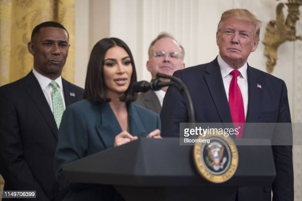 President Donald Trump, right, listens as reality star and activist Kim Kardashian West speaks about a second chance hiring and re-entry initiative...