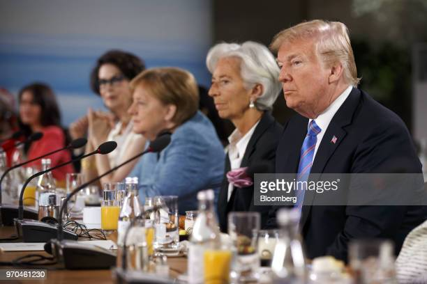 US President Donald Trump right listens during the Group of Seven Gender Equality Advisory Council Breakfast at the G7 Leaders Summit in La Malbaie...