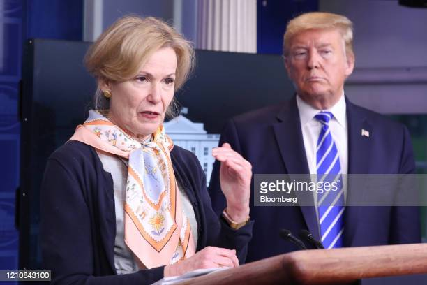 US President Donald Trump right listens to Deborah Birx coronavirus response coordinator as she speaks during a news conference in the White House in...