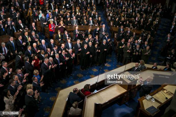 US President Donald Trump right pauses while delivering a State of the Union address to a joint session of Congress at the US Capitol in Washington...