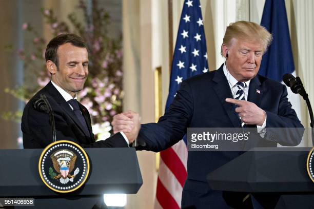 S President Donald Trump right points to Emmanuel Macron France's president at a news conference during a state visit in the East Room of the White...