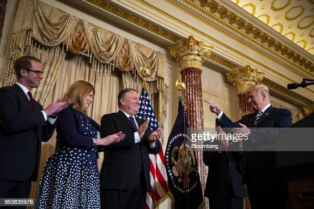 US President Donald Trump right points while speaking as Nick Pompeo from left Susan Pompeo Mike Pompeo US secretary of state and US Vice President...