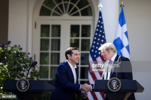 US President Donald Trump right shakes hands with Alexis Tsipras Greece's prime minister sfollowing a joint press conference in the Rose Garden of...