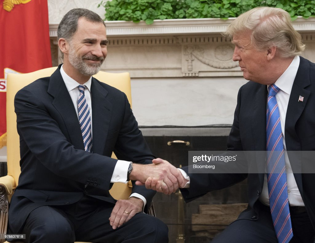 U.S. President Donald Trump, right, shakes hands with Felipe VI, Spain's king, during a meeting in the Oval Office of the White House in Washington, D.C., U.S., on Tuesday, June 19, 2018. King Felipe and Queen Letizia are beginning a visit to the U.S., celebrating the 300th anniversaries of the founding of New Orleans and San Antonio. Photographer: Chris Kleponis/Pool via Bloomberg