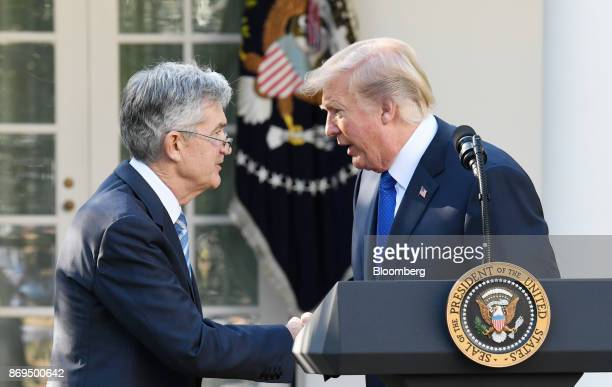 US President Donald Trump right shakes hands with Jerome Powell governor of the US Federal Reserve and Trump's nominee as chairman of the Federal...
