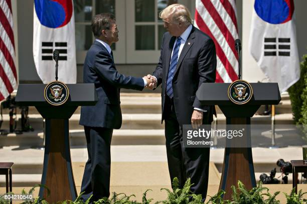 US President Donald Trump right shakes hands with Moon Jaein South Korea's president during a joint statement in the Rose Garden of the White House...